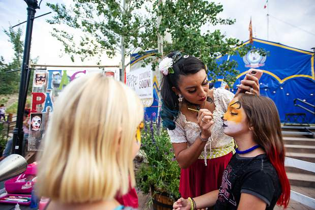 Sophia Estevan, 12, gets her face painted outside of the Zoppe Italian Family Circus tent in Snowmass Base Village.