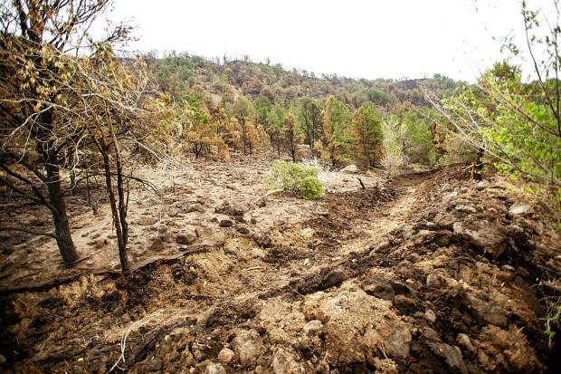 Trenches created by Cory Ross, an employee of Ace Lane's in El Jebel to help protect the property from mudslides that occurred on Saturday from rainfall on the burn scar from the Lake Christine Fire on Wednesday afternoon.