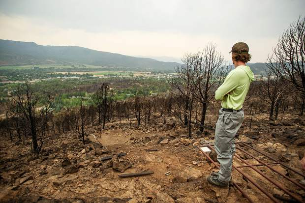 Indy Lane standing on the edge of his family's property in El Jebel that was destroyed by the Lake Christine Fire. The Lane family also encountered flash flooding from Saturday's storms creating mudslides on their property.