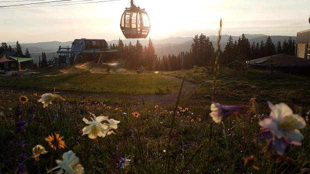 While waiting for the racers to hit the top of Aspen Mountain last Sunday for the Power of Four foot race, our Times editor caught this shot of the sunrise from the Sundeck.