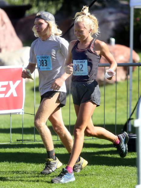 The brother-sister duo of Lauren and James Gregory, of Fort Collins, finish 1-2 in the Aspen Backcountry Half Marathon on Saturday, Aug. 11, 2018, at Rio Grande Park. (Photo by Austin Colbert/The Aspen Times).