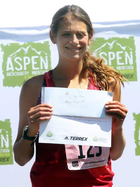 Texas native Kelsey Persyn stands on the podium after winning the Aspen Backcountry Marathon on Saturday, Aug. 11, 2018, at Rio Grande Park. (Photo by Austin Colbert/The Aspen Times).