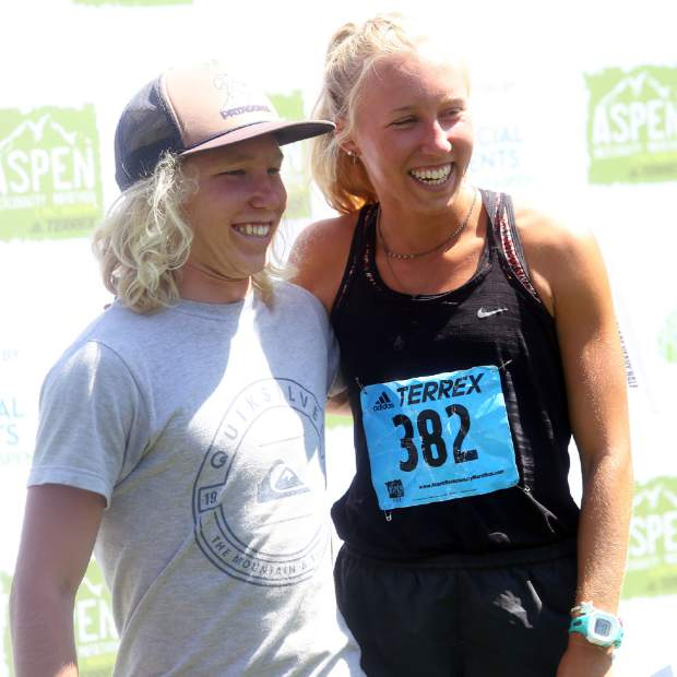 The brother-sister duo of Lauren and James Gregory, of Fort Collins, stand atop the podium after finishing 1-2 in the Aspen Backcountry Half Marathon on Saturday, Aug. 11, 2018, at Rio Grande Park. (Photo by Austin Colbert/The Aspen Times).