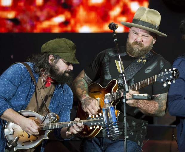 Coy Bowles, left, and Zac Brown of the Zac Brown Band at Fenway Park in June. The band headlines the Jazz Aspen Snowmass Labor Day Experience on Sunday.