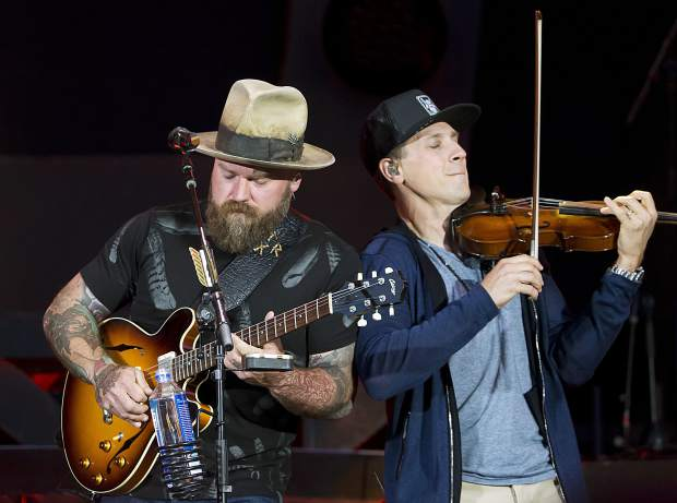 Zac Brown, left, and Jimmy De Martini perform with the Zac Brown Band at Fenway Park in June. The band's summer-long