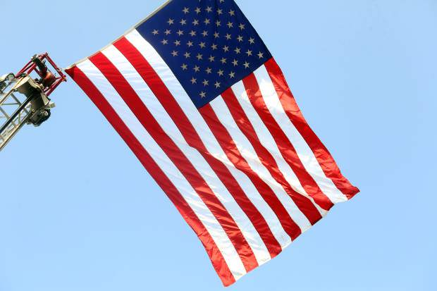 The American flag waves in the wind during the National Night Out event on Tuesday, Aug. 7, 2018 at Triangle Park in Willits.