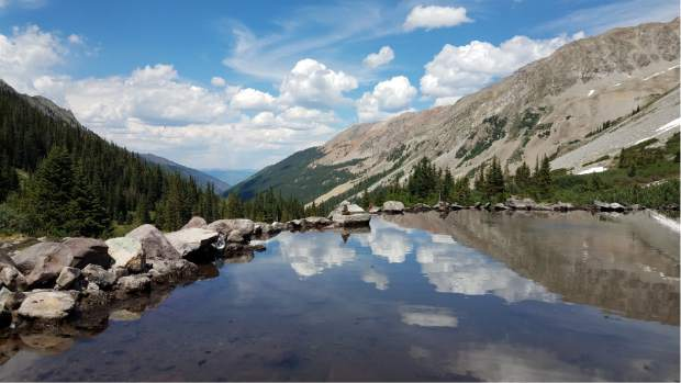 Conundrum Hot Springs are a popular hiking destination near Aspen. It is a 8.5-mile hike from the trail ahead to the springs, which sit at 11,222 feet. (David Krause/The Aspen Times)