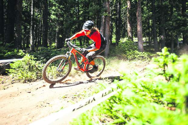 A biker takes a practice run on the stage 1 portion of the Big Mountain Enduro course on Aspen Mountain on Thursday.