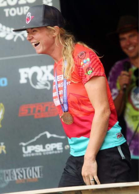 Crested Butte's Cooper Ott laughs on the podium after winning the women's pro open division of the Big Mountain Enduro Finals on Sunday, Aug. 5, 2018, in Snowmass. (Photo by Austin Colbert).