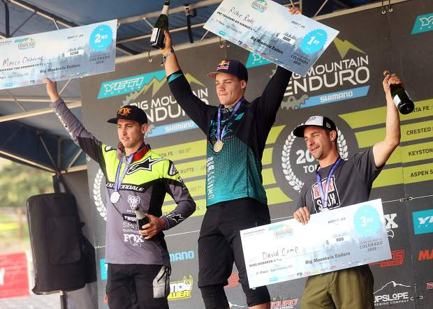 Richie Rude, center, stands on the men's pro division podium during the Big Mountain Enduro Finals on Sunday, Aug. 5, 2018, in Snowmass. (Photo by Austin Colbert).