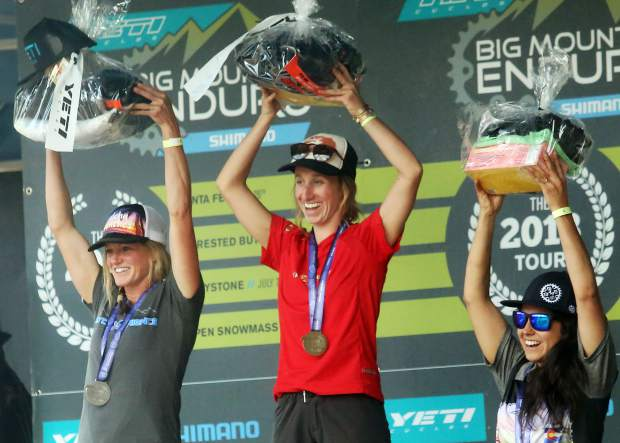 Isabelle Zaik, center, stands on the amateur women's podium of the Big Mountain Enduro Finals on Sunday, Aug. 5, 2018, in Snowmass. (Photo by Austin Colbert).