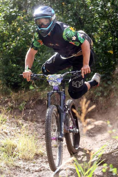 Basalt's Rafaelo Infante hops back on his bike on Stage 5 of the Big Mountain Enduro Finals on Sunday, Aug. 5, 2018, in Snowmass. (Photo by Austin Colbert).