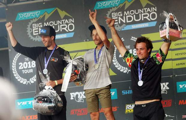 Aspen's Whit Boucher, center, stands on the podium after winning the men's expert division of the Big Mountain Enduro stage race on Sunday, Aug. 5, 2018, in Snowmass Village. At his left taking second was fellow Aspenite Matt Boughton and right was third-place finisher Rafaelo Infante of Basalt. (Photo by Austin Colbert).
