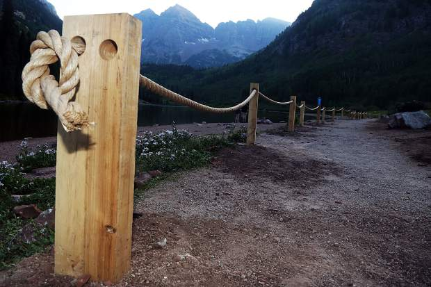 A set of posts connected by rope, seen here on Tuesday, Aug. 7, 2018, were recently installed near Maroon Lake to help curb the