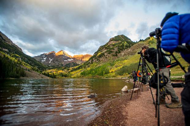 Photographers line the shore of Maroon Lake near the Maroon Bells on the morning of September 20, 2017.
