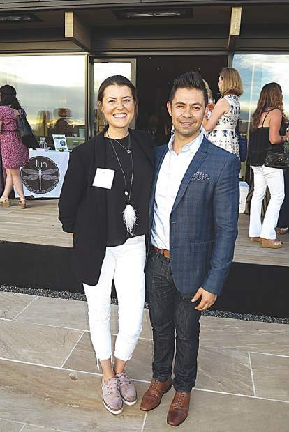 Brittanie Rockhill and Ivan Estrada with Douglas Elliman Real Estate.