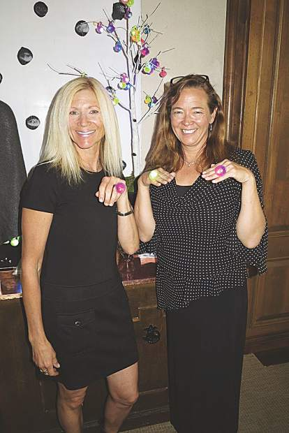 "Beverly Weaver and Jennifer Calkins model ""bling rings,"" offered as a raffle entry to win a jewelry prize by Stephanie Kantis."