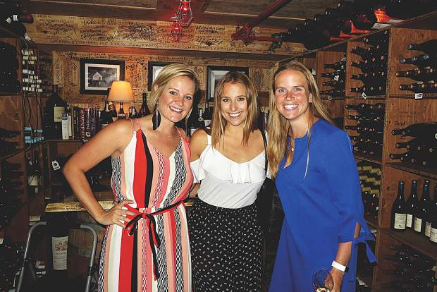 TIffany Cook, Jenna Linden and Chloe Rekow at a wine tasting in a secret cellar this summer.