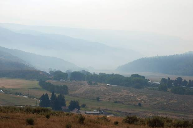 The new normal for summers in the central Rocky Mountains? Smoke hangs inthe White River Valley Thursday near Meeker.
