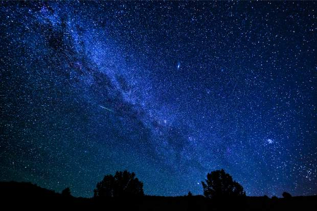 Perseid Meteor Shower - Milky Way galaxy and stars at night during summer meteor shower.