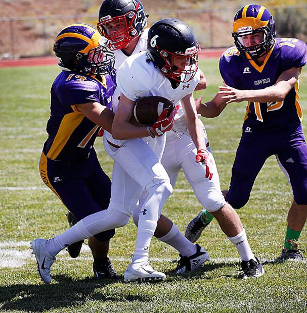 Alec Demko of Bayfield High School makes a tackle while playing Aspen on Saturday at BHS.
