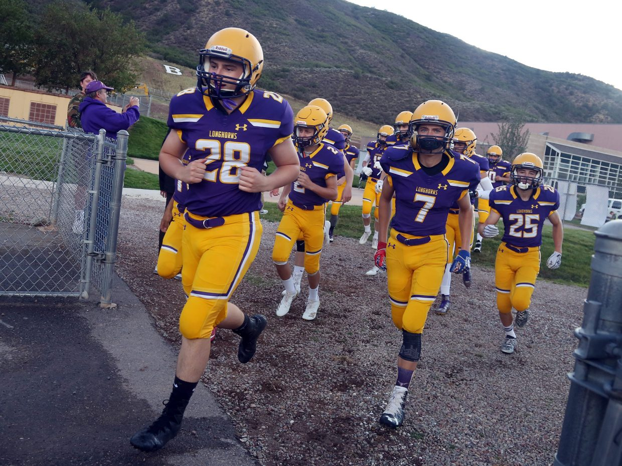The Basalt High School football team walks onto the field ahead of Friday's season opener against Olathe. (Photo by Austin Colbert/The Aspen Times).