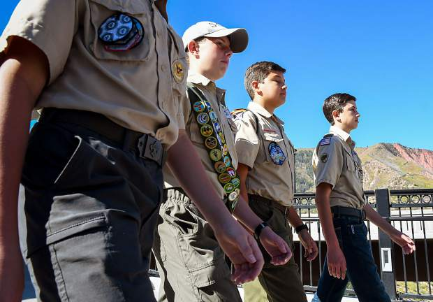 Members of Boy Scout Troop 225 lead the parade across the Grand Avenue pedestrian bridge during Saturday's Big Birthday Bash at the Hotel Colorado.