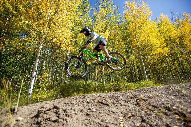 Snowmass Village local Jay Morin hits a jump at the Snowmass bike park on Sept. 22, 2018.