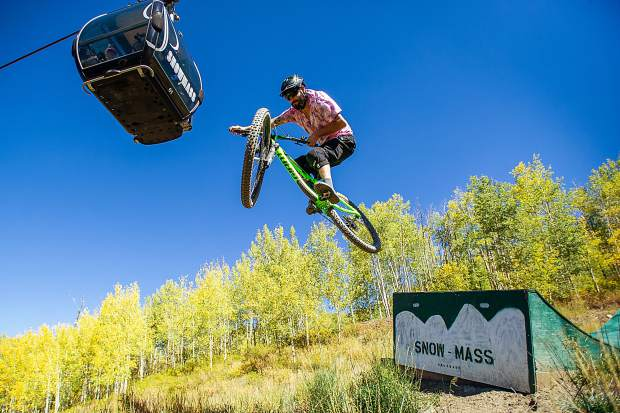Snowmass Village local Jay Morin hits a jump at the Snowmass bike park on Sept. 22. This is the final weekend of the season that the lifts at the bike park will run.
