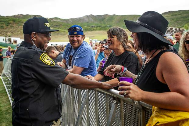 Cory, the Citadel Security guard in the pit chats with members in the front row before Fitz and the Tantrums for JAS Labor Day Experience on Saturday.
