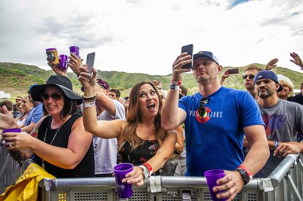 Members in the front row take photos and video of Fitz and the Tantrums for JAS Labor Day Experience on Saturday.