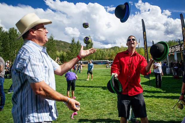 Jammin' Jim, right, and Bill Rey juggle in the vendor village on Saturday for the JAS Labor Day Experience.