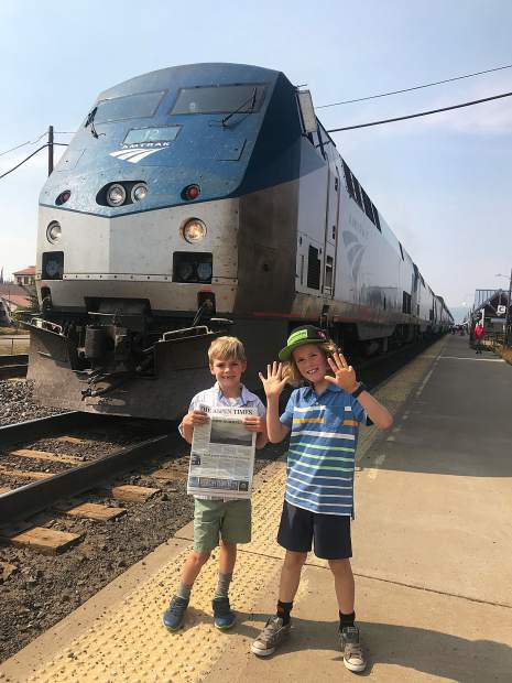 Aiden, 6, and Jack Haynie, 9, took a quick stop from the California Zephyr en route to Denver to celebrate the end of summer and a couple of birthdays, and brought along a copy of The Aspen Times.