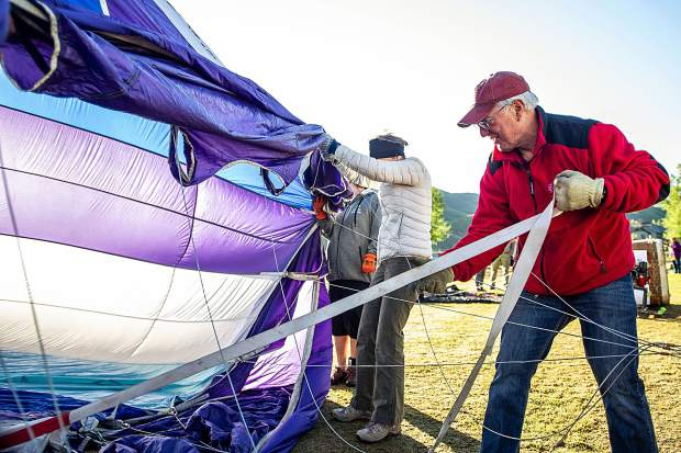 Colorado Springs Pilot Stephen Blucher inflates the envelope of his balloon
