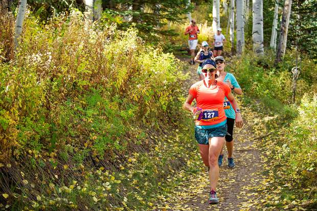 Racers in the Golden Leaf Half Marathon on Saturday around milemarker 4 on the Government Trail in Snowmass.