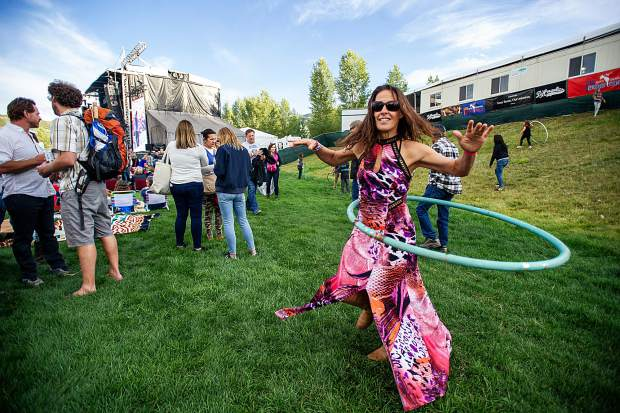 Betty Hoops hula hooping at the Jazz Aspen Snowmass Labor Day experience concerts.