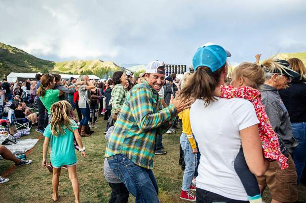 A family dances to Michael Franti and Spearhead Friday evening for the Jazz Aspen Snowmass concert.
