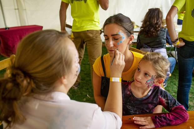 Nicole Weinstein gets her face painted by Sheabrea Carson in the JAS village while her niece Lexi Gerber, 4, watches on Friday before the Jazz Aspen Snowmass concerts.