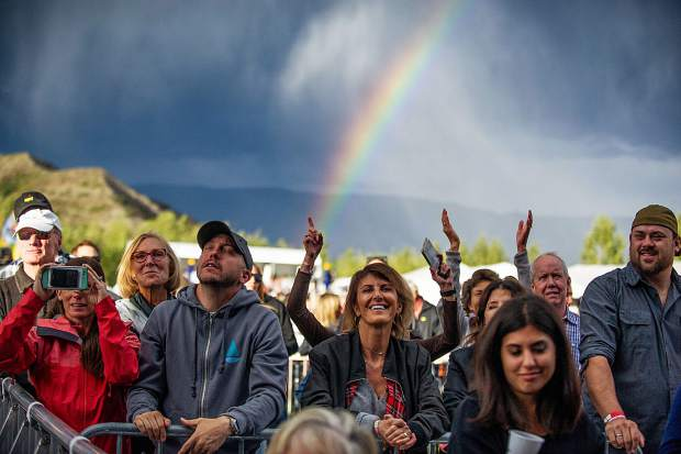 A rainbow shines over members in the VIP area at the Jazz Aspen Snowmass concert on Friday evening.