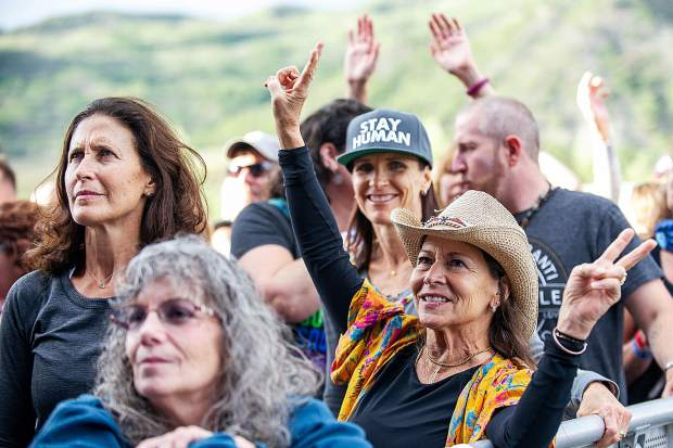 A crowd member throws up peace signs during Michael Franti and Spearhead's set at the Jazz Aspen Snowmass Labor Day Experience on Friday.