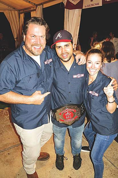 The 2018 Aspen BBQ Cook-Off champions Chris Lanter, Kyle Wilkins and Amy Fritzche of.Home Team BBQ.