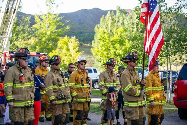 Snowmass-Wildcat Fire Protection District before taking off Tuesday night at the 3rd Annual Axes and Arms 9/11 Climb. The event was to honor those who lost their lives on 9/11/2001, and the lives of all whom have made the ultimate sacrifice of service before and since. Hikers and first responders hiked to the same elevation that the brave men and women of FDNY did in the first tower of The World Trade Center, gaining 956ft of elevation over 3 miles. The climb began at the Snowmass Town Park and finished at the Top of the Village Condos.