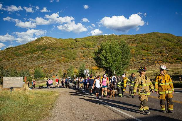 Snowmass-Wildcat Fire Protection District and community members starting their hike on Brush Creek Road in Snowmass Tuesday night at the 3rd Annual Axes and Arms 9/11 Climb. The event was to honor those who lost their lives on 9/11/2001, and the lives of all whom have made the ultimate sacrifice of service before and since. Hikers and first responders hiked to the same elevation that the brave men and women of FDNY did in the first tower of The World Trade Center, gaining 956ft of elevation over 3 miles. The climb began at the Snowmass Town Park and finished at the Top of the Village Condos.