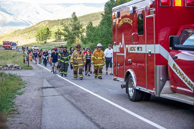 Snowmass-Wildcat Fire Protection District and community members during their hike on Brush Creek Road in Snowmass Tuesday night at the 3rd Annual Axes and Arms 9/11 Climb. The event was to honor those who lost their lives on 9/11/2001, and the lives of all whom have made the ultimate sacrifice of service before and since. Hikers and first responders hiked to the same elevation that the brave men and women of FDNY did in the first tower of The World Trade Center, gaining 956ft of elevation over 3 miles. The climb began at the Snowmass Town Park and finished at the Top of the Village Condos.