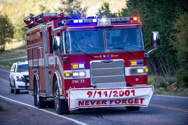 The Snowmass fire engine brings up the rear at the 3rd annual Axes and Arms 9/11 climb on Brush Creek Road in Snowmass on Tuesday night.