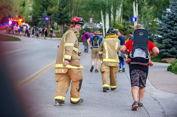 Snowmass Firefighter Jake Andersen looks back and smiles while finishing up the 3rd annual Axes and Arms 9/11 climb on Brush Creek Road in Snowmass on Tuesday night. The event was to honor those who lost their lives on 9/11/2001, and the lives of all whom have made the ultimate sacrifice of service before and since. Hikers and first responders hiked to the same elevation that the brave men and women of FDNY did in the first