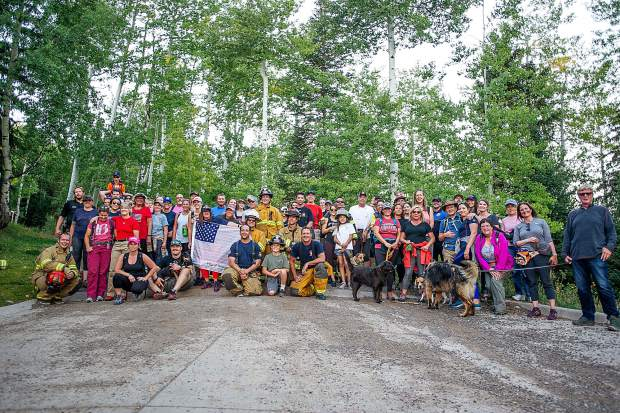 A group photo at the end of the 3rd annual Axes to Arms remembrance event in Snowmass on Tuesday evening. The event was to honor those who lost their lives on 9/11/2001, and the lives of all whom have made the ultimate sacrifice of service before and since. Hikers and first responders hiked to the same elevation that the brave men and women of FDNY did in the first