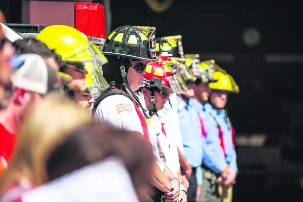 Aspen firefighters stand in silence during the 17th annual day of remembrance Tuesday afternoon outside of the Aspen fire station.