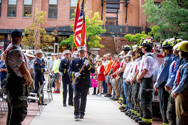 The Aspen Fire Honor Guard retires the Colors Tuesday afternoon at a remembrance ceremony outside the Aspen Fire Department on the 17th anniversary of the 9/11 attacks in New York.
