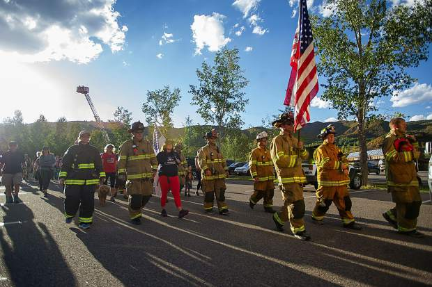 Snowmass-Wildcat Fire Protection District starting their hike Tuesday night at the 3rd Annual Axes and Arms 9/11 Climb. The event was to honor those who lost their lives on 9/11/2001, and the lives of all whom have made the ultimate sacrifice of service before and since. Hikers and first responders hiked to the same elevation that the brave men and women of FDNY did in the first tower of The World Trade Center, gaining 956ft of elevation over 3 miles. The climb began at the Snowmass Town Park and finished at the Top of the Village Condos.